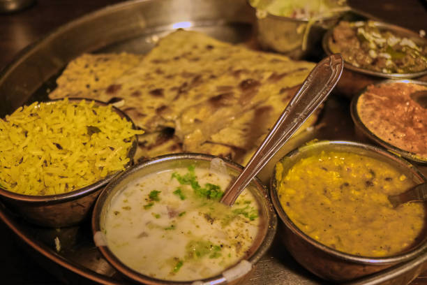Closeup of colorful Thali set meal with a yellow rice, a dal and delicious sauces from Amritsar, India. stock photo