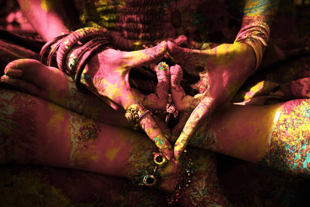 closeup of colorful woman hand in mudra gesture stock photo