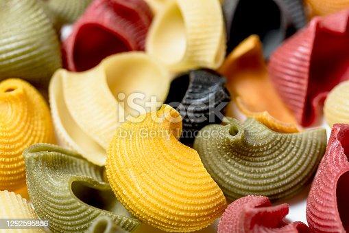 istock Close-up of coloured Italian snail paste made from durum wheat semolina 1292595886