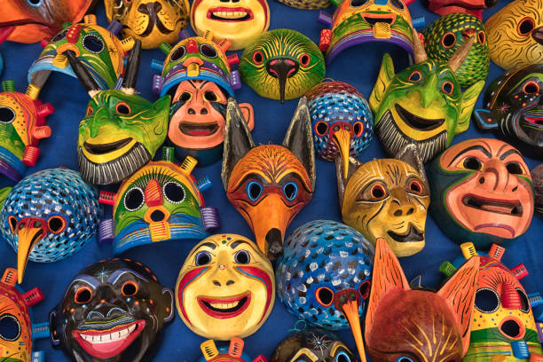 closeup of colourful indigenous wood carvings stock photo