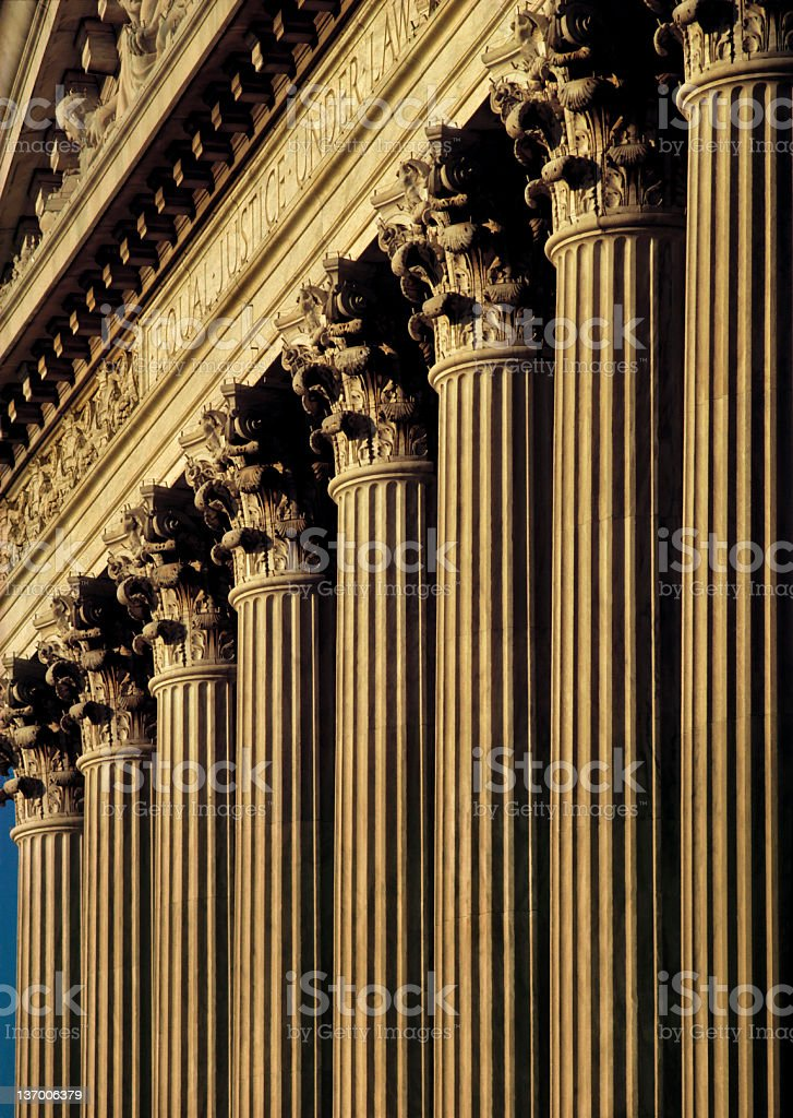 A close-up of columns on the exterior of a courthouse royalty-free stock photo
