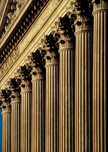 A close-up of columns on the exterior of a courthouse stock photo