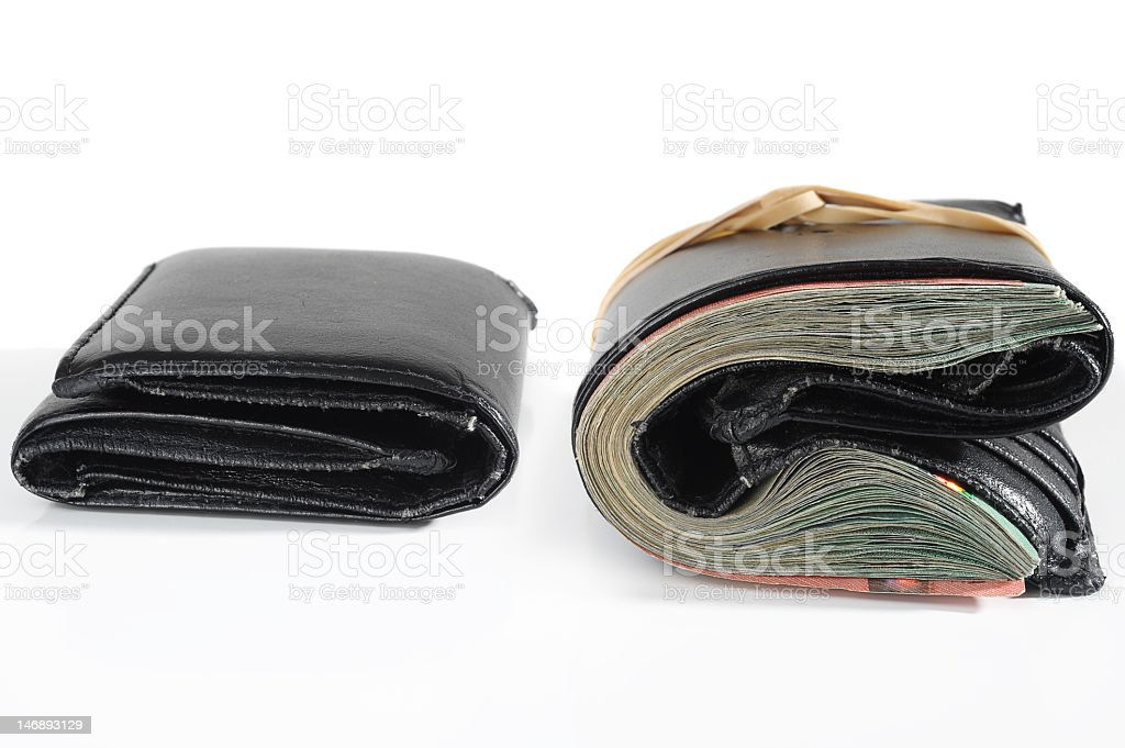 Close-up of comparison of same wallet with and without money Empty and full wallet on white background Absence Stock Photo