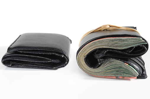 Closeup Of Comparison Of Same Wallet With And Without Money Stock Photo - Download Image Now