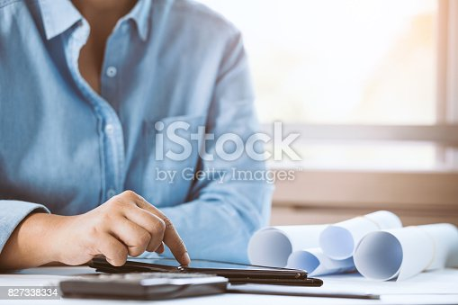 istock Close-up of confident architect female pointing on smart phone in office. Concept building on project. 827338334