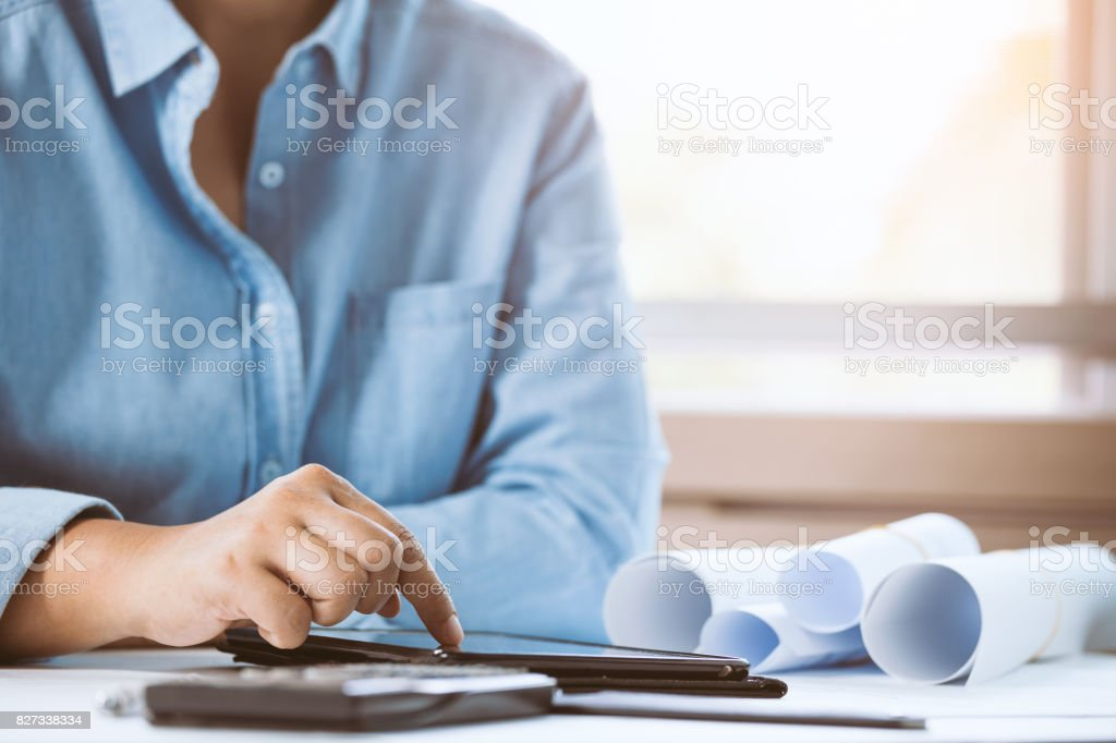 Close-up of confident architect female pointing on smart phone in office. Concept building on project. stock photo