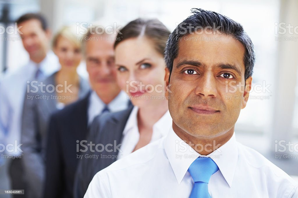 Closeup of confident mature man with colleagues in a row royalty-free stock photo