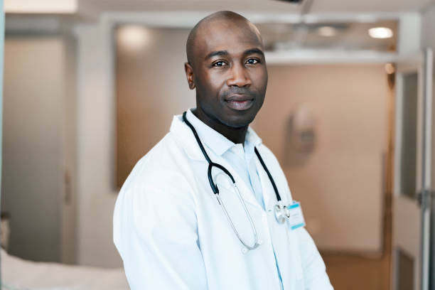 Close-up of confident mid adult male doctor stock photo