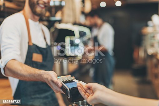 istock Close-up of contactless credit card payment 689366732