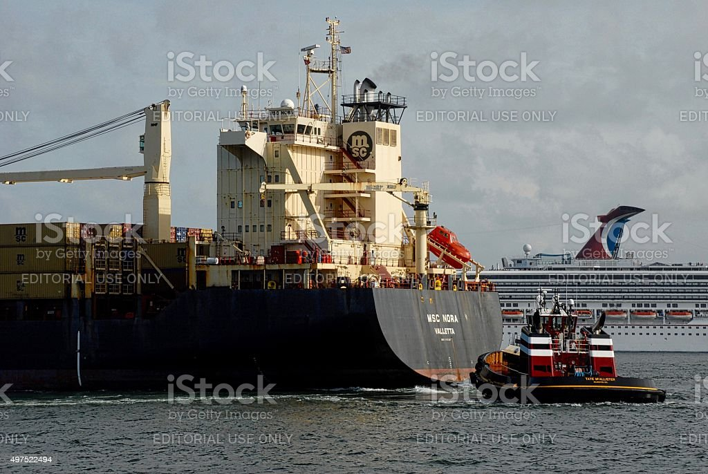 Close-up of Container Ship, Tugboat and Cruise Ship in Background stock photo