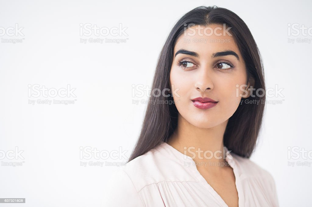 Closeup of Content Young Attractive Indian Lady stock photo