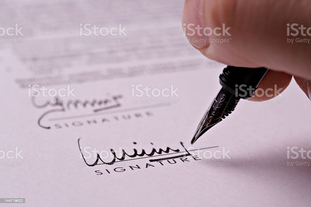 Close-up of contract signature in calligraphy pen stock photo