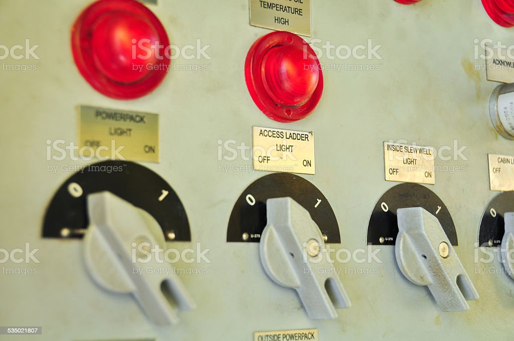 Closeup of control dials on manufacturing machinery stock photo