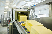 Roller conveyor with butter cubes