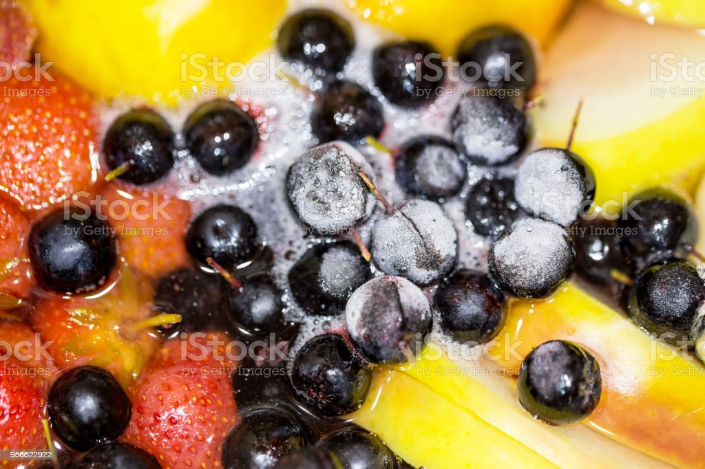 Close-up of cooking compote drink from fresh and frozen fruits and berries. Non-alcoholic tasty punch drink stock photo