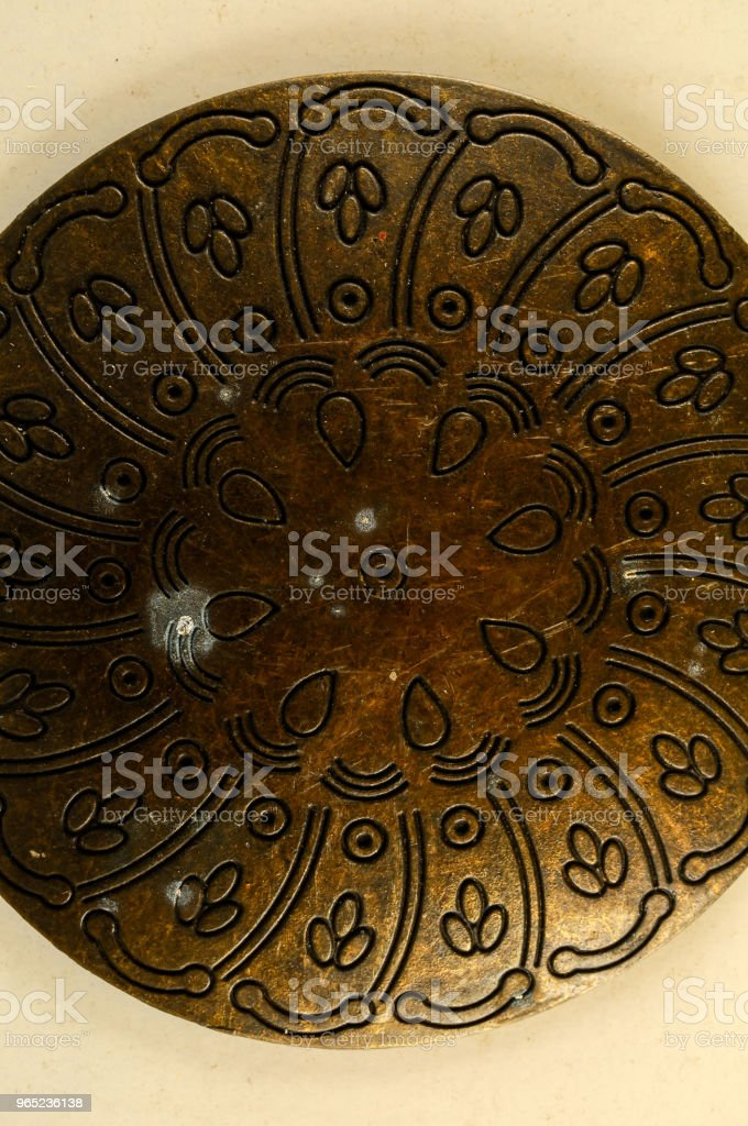 Close-up of copper oriental ornament royalty-free stock photo