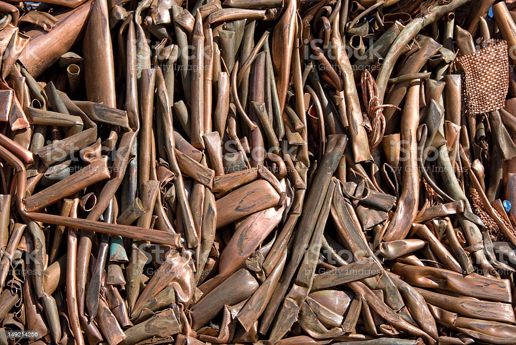 Close-up of copper pipes in a pile royalty-free stock photo
