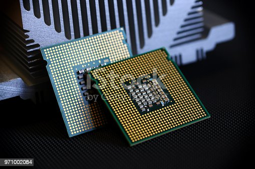 155152430istockphoto closeup of cpu processor on aluminum heat sink cooler 971002084
