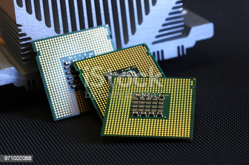 155152430istockphoto closeup of cpu processor on aluminum heat sink cooler 971002088