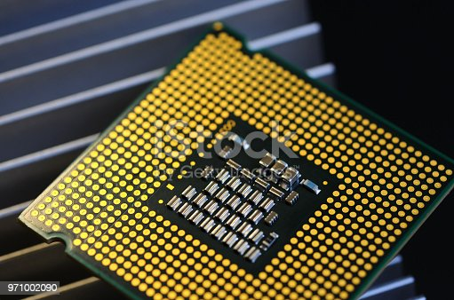 155152430istockphoto closeup of cpu processor on aluminum heat sink cooler 971002090
