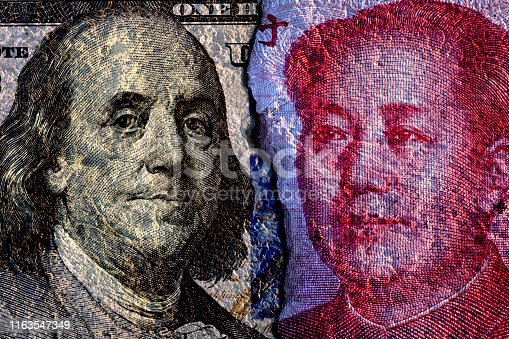 istock Closeup of cracked of Face to face of US dollar banknote and China Yuan banknote for 2 biggest economic in the world which now United states of America and China have war trade.Both countries conflict 1163547349