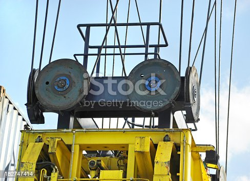 close-up of crane lifts heavy cargo container in harbor