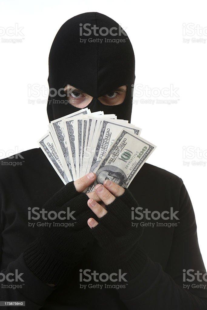 Closeup of criminal holding money royalty-free stock photo