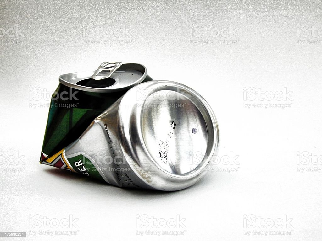 Close-up of crushed aluminum drink can on white background stock photo