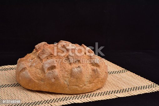 913749618 istock photo Close-up of crusty garlic bread on wooden background 913749348
