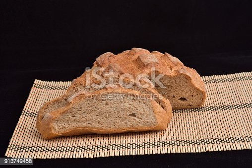 913749618istockphoto Close-up of crusty garlic bread on wooden background 913749458