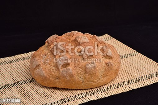 913749618istockphoto Close-up of crusty garlic bread on wooden background 913749466