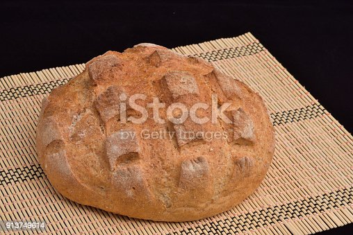 913749618istockphoto Close-up of crusty garlic bread on wooden background 913749614