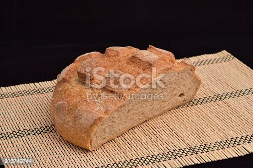 913749618 istock photo Close-up of crusty garlic bread on wooden background 913749744