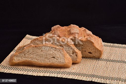 913749618istockphoto Close-up of crusty garlic bread on wooden background 913749832