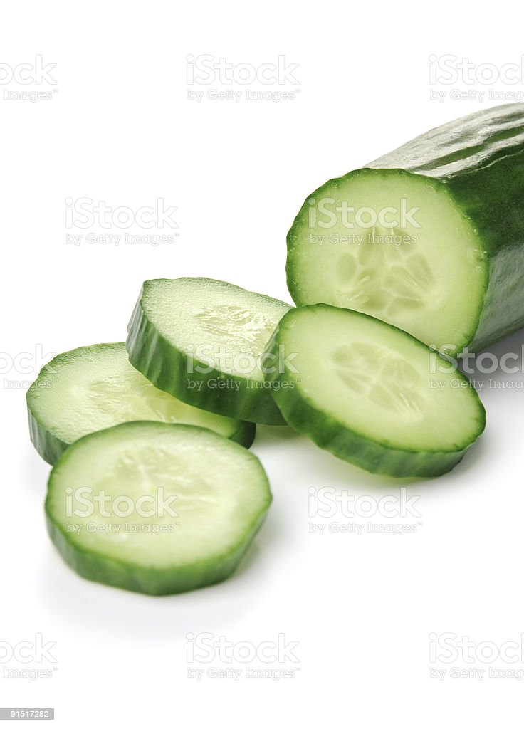 Close-up of cucumber with 4 fresh slices royalty-free stock photo