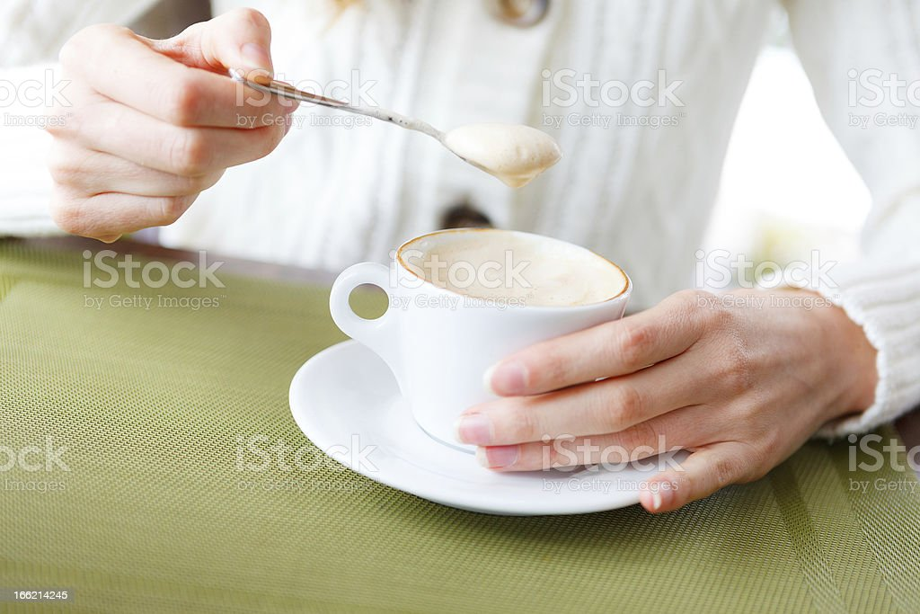 Closeup of cup coffee and woman hands royalty-free stock photo