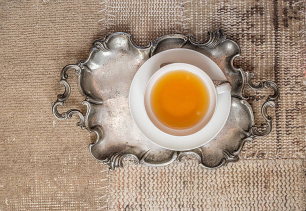 Closeup of cup of tea on vintage textile background stock photo