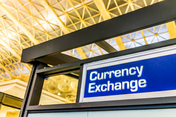 Closeup of currency exchange sign inside building stock photo