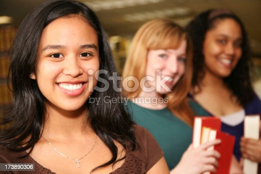 488149772istockphoto Closeup of Cute Female College Student with her Friends 173890306