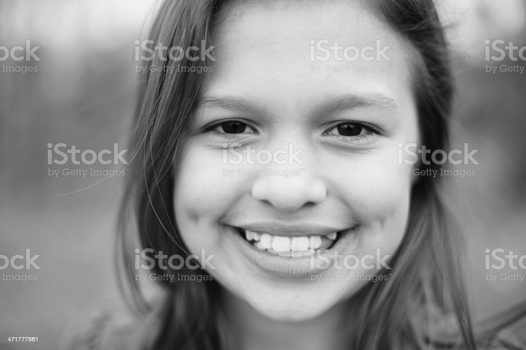 Closeup of Cute Girl With Dimples in Black and White royalty-free stock photo
