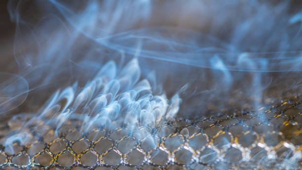 Close-up of dangerous smoke fumes and scorched netting. Idea of fire, industry, environment stock photo
