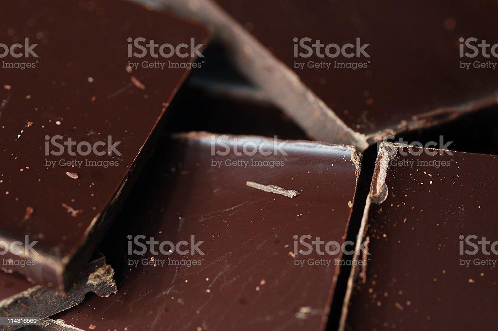 Close-up of dark chocolate pieces royalty-free stock photo