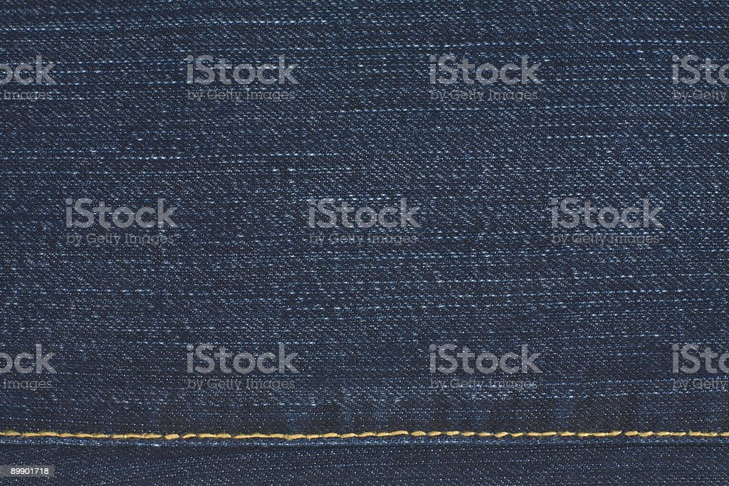 Closeup of Dark Denim Fabric Background With Stitching royalty-free stock photo