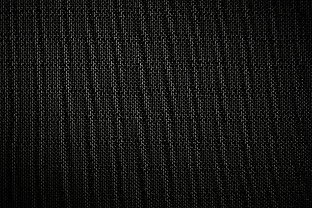 close-up of dark texture background of black fabric with spotlight. - nylon texture stock pictures, royalty-free photos & images