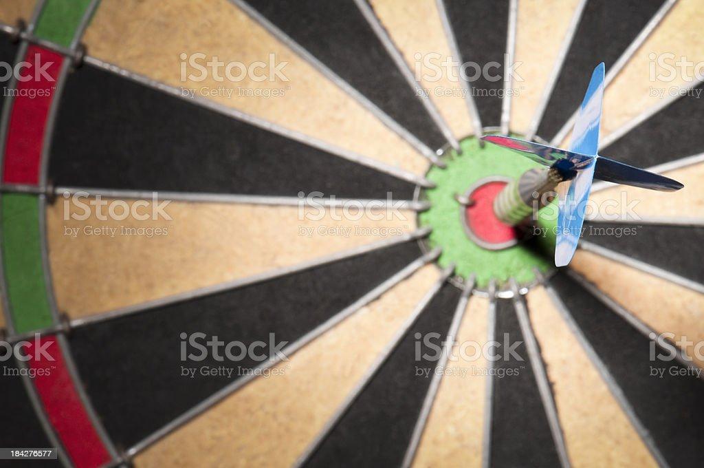 Close-up of dart hitting the bullseye royalty-free stock photo
