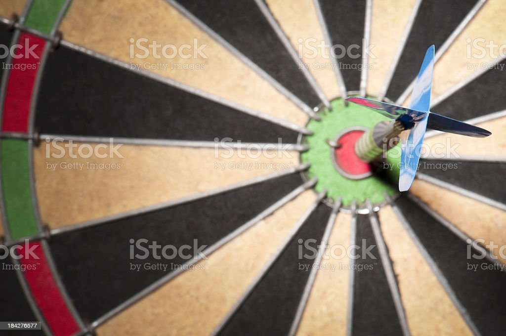 Close-up of dart hitting the bullseye stock photo