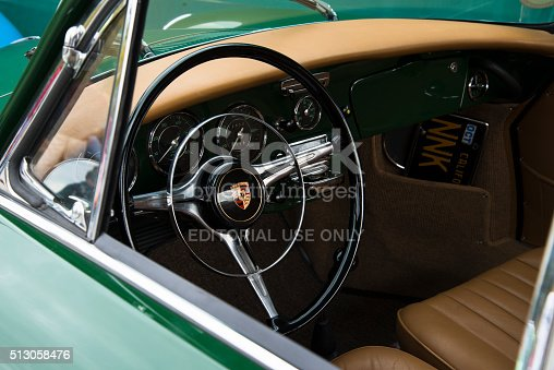 Anaheim, CA, USA - March 3, 2013: A look through the window of a vintage green Porsche 356, with a view of the steering wheel, dashboard, gauges, and restored beige upholstery at the 4th Annual Southern California All Porsche Swap and Car Display, which took place at The Phoenix Club.