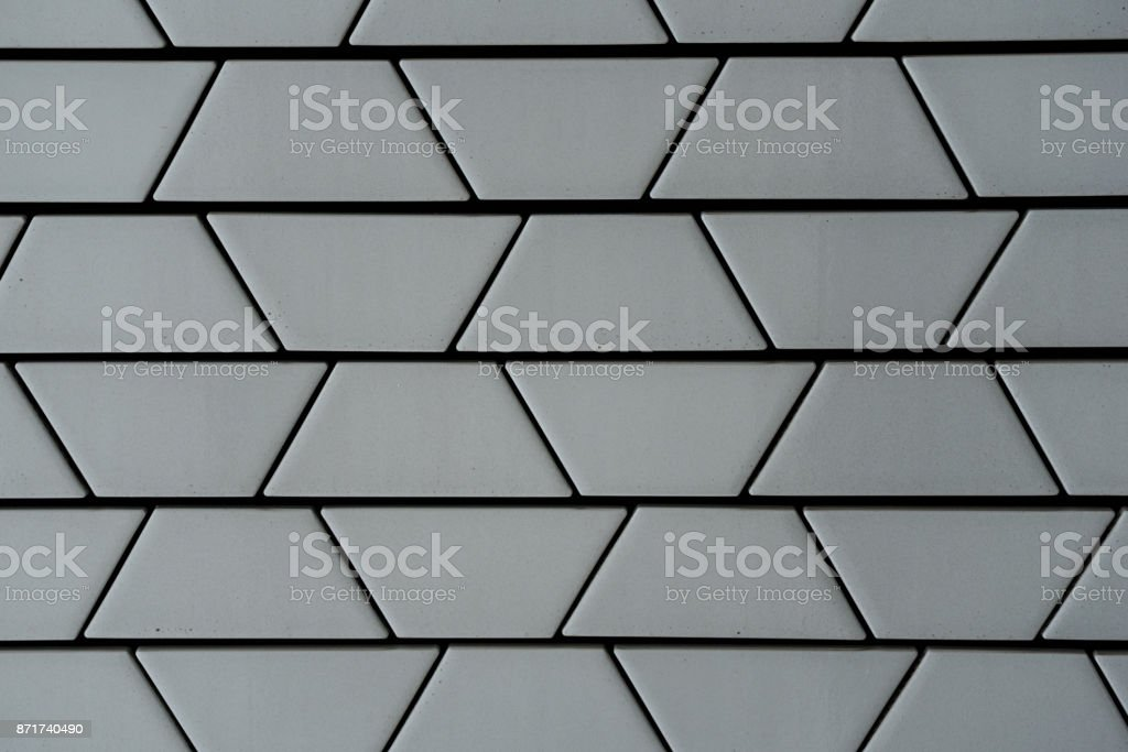 Close-up of decorative ceramic white brick wall in trapezoid pattern stock photo