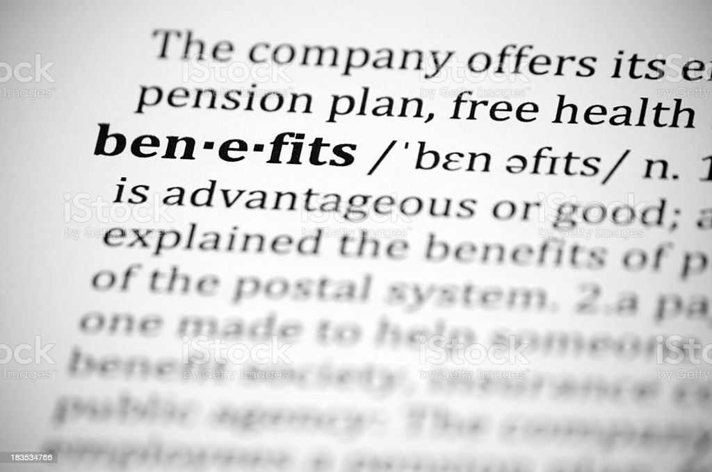 Close-up of definition of word Benefits in dictionary royalty-free stock photo