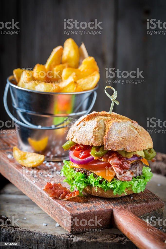 Closeup of delicious hamburger made of onion, tomato and lettuce stock photo